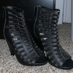 Black caged heels by Steve Madden